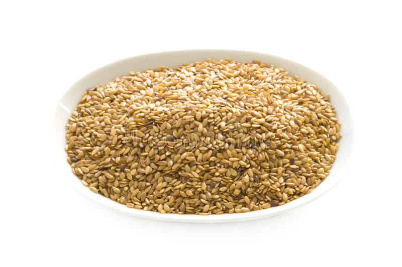 Изолированные льняное семя или flaxseed стоковое изображение rf