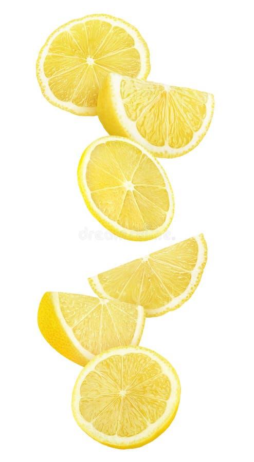 Изолированные падая части лимона стоковое изображение