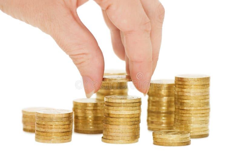 изолированные руки монеток стоковая фотография rf