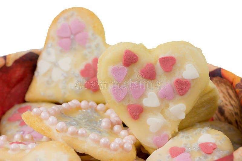 Изолированные сладостные печенья рождества в форме сердца стоковая фотография