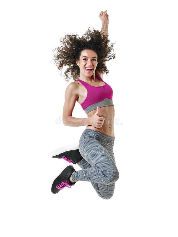 Изолированные тренировки фитнеса танцев танцора zumba женщины стоковое фото