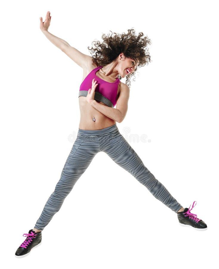 Изолированные тренировки фитнеса танцев танцора zumba женщины стоковое фото rf