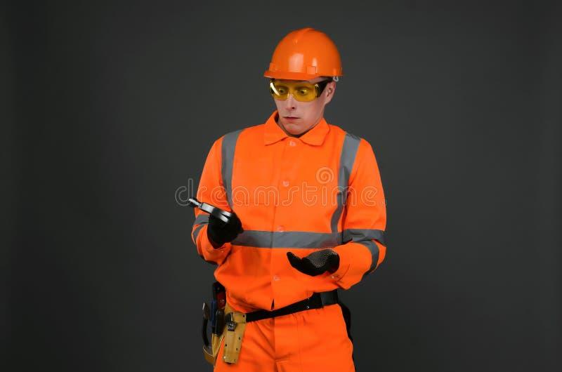 изолированный конструкцией славный работник обмундирования стоковая фотография rf