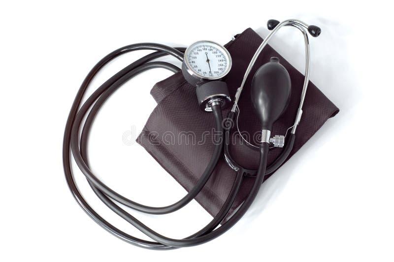 изолированный кровью ручной медицинский инструмент давления монитора стоковое фото