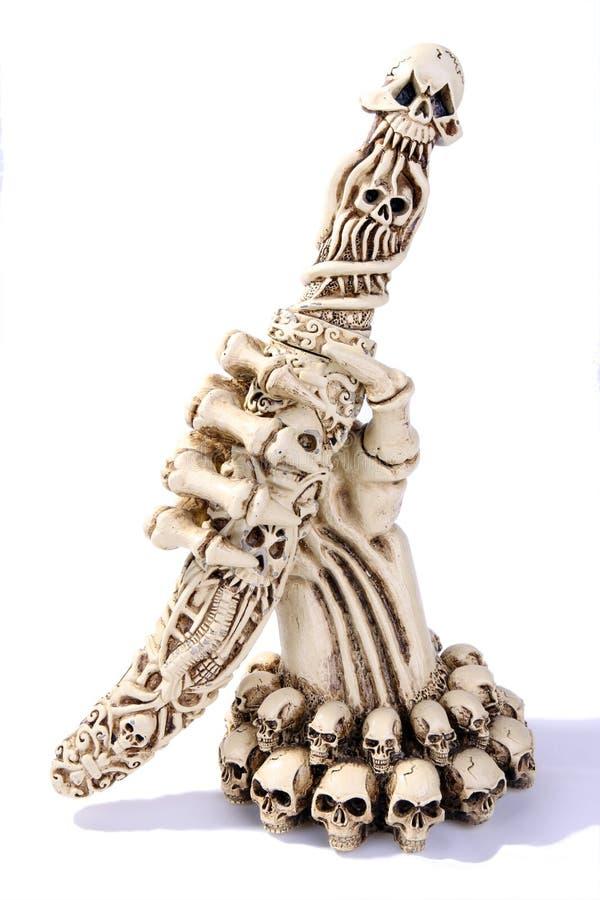 изолированный рукой скелет цвета слоновой кости бумаги ножа стоковая фотография