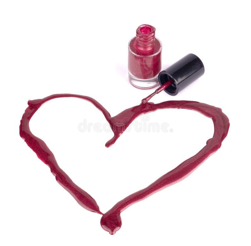 изолированный сердцем красный цвет маникюра стоковые фотографии rf