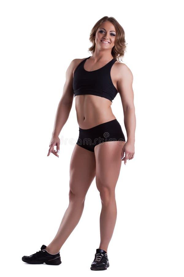 Изолированный строитель тела высоты сильной женщины полный стоковое фото rf