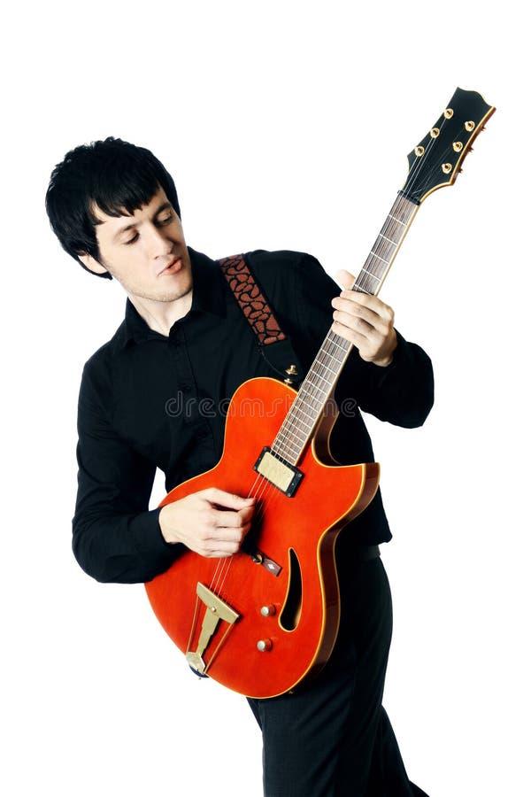 Изолированный человек гитары электрический стоковое фото