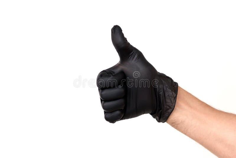 Изолируйте руку человека в черной резиновой перчатке на белой предпосылке стоковая фотография