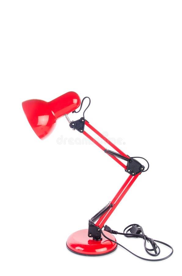 Изолированная лампа красной столешницы регулируемая на белизне стоковые фото