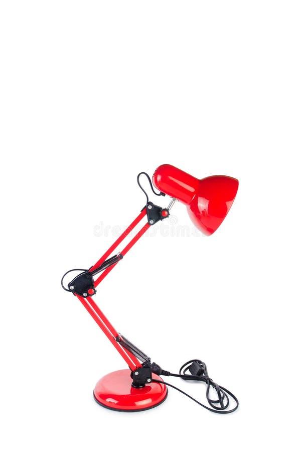 Изолированная лампа красной столешницы регулируемая на белизне стоковое фото