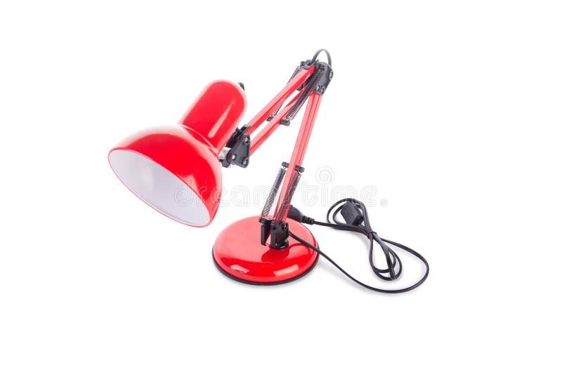 Изолированная лампа красной столешницы регулируемая на белизне стоковое фото rf