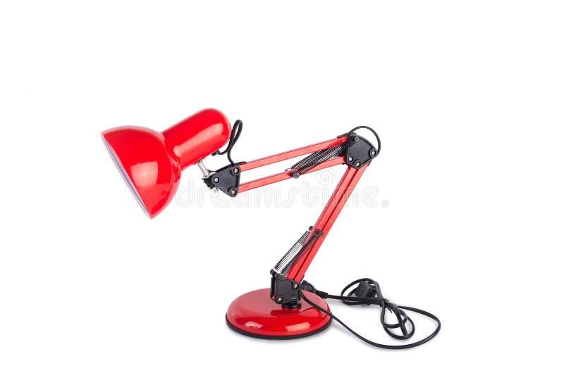 Изолированная лампа красной столешницы регулируемая на белизне стоковое изображение