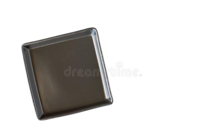 Изолированная квадратная черная плита стоковые изображения rf