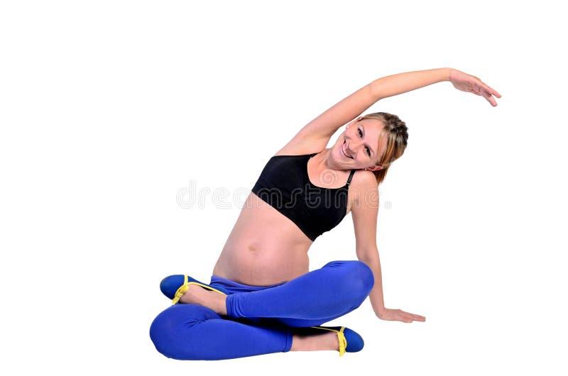 Изолированная молодая беременная женщина стоковое изображение rf