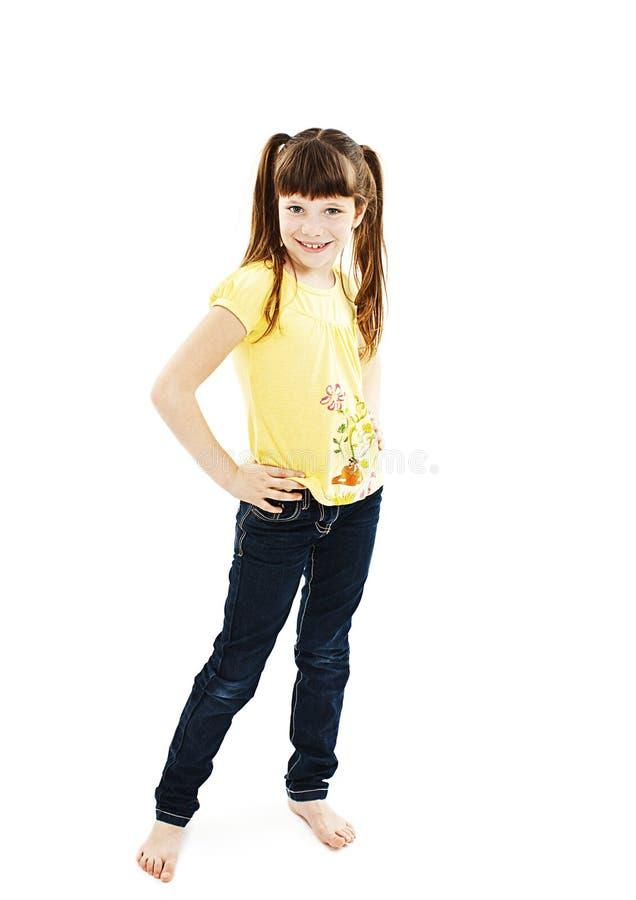изолированное счастливое девушки предпосылки немногой представляя белизну стоковое фото