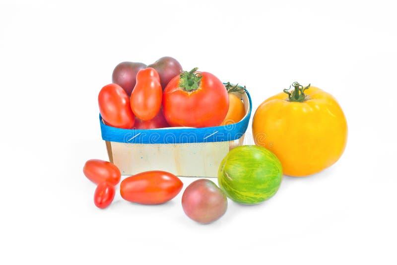 Изолированные томаты ассортимента органические vegetable красочные стоковое фото rf