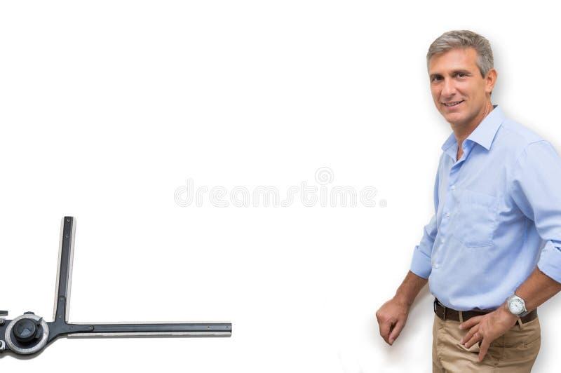 Изолированный архитектор на белой доске стоковая фотография