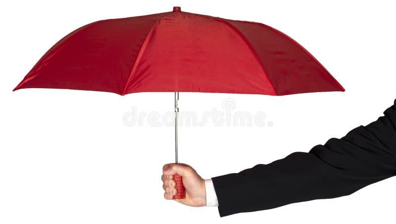 Изолированный зонтик удерживания руки бизнесмена красный стоковые фото