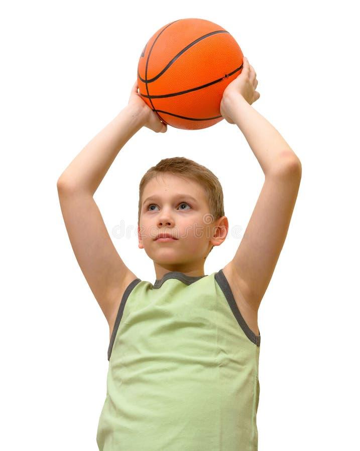 Изолированный мальчик с баскетболом стоковые фотографии rf
