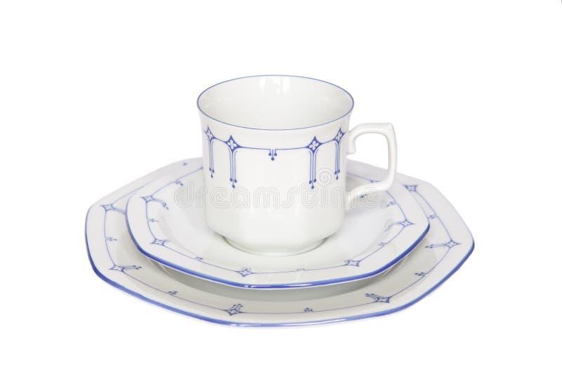 Изолированный фарфор плиты поддонника Coffeecup стоковая фотография rf