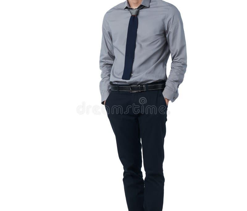 Изолируйте человека в ультрамодном костюме стоя самостоятельно в белой предпосылке стоковые изображения rf