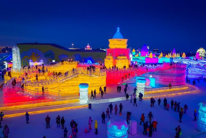 Изумительный заход солнца во время льда и фестиваля скульптуры снега, Харбин, Китая стоковые фотографии rf