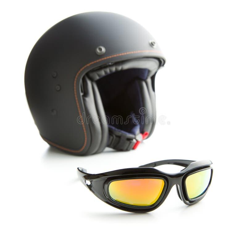 Изумлённые взгляды и шлем мотоцикла стоковая фотография