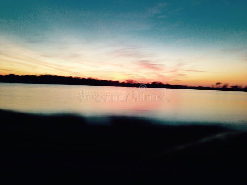 Из маленького города заход солнца стоковые изображения rf