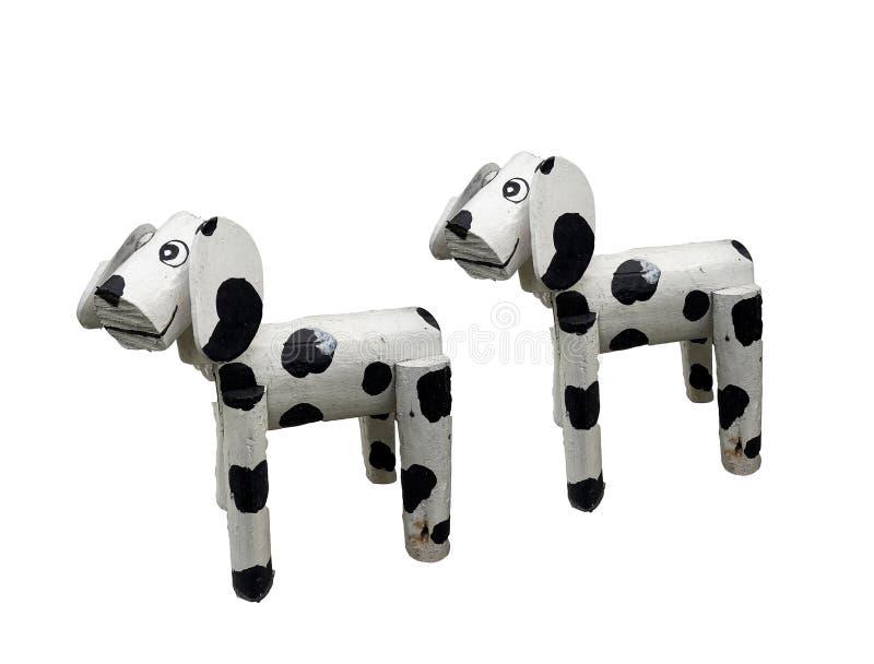 2 из standind маленьких деревянных собак белого смешанного черного покрашенного изолированного на белой предпосылке стоковое изображение rf