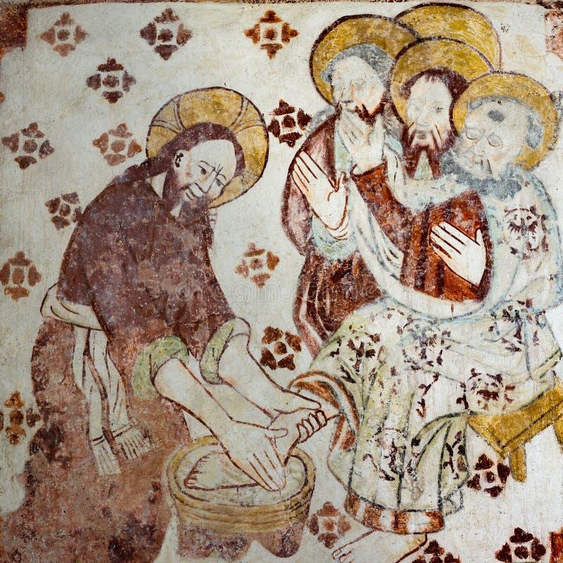 Иисус моет ноги учеников стоковое изображение