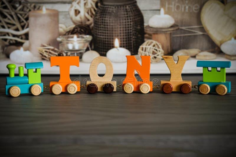 Имя, составленное из деревянных букв стоковые фото