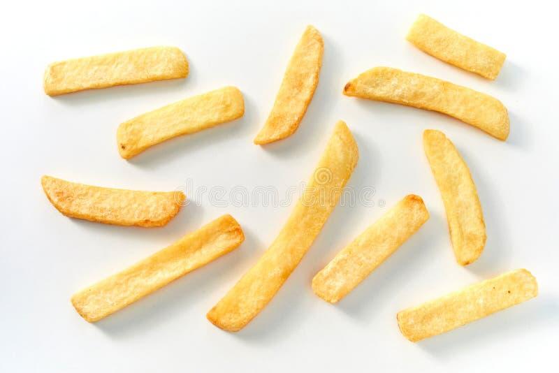 Индивидуальные большие pommes стейка или французские обломоки картофеля фри стоковое фото