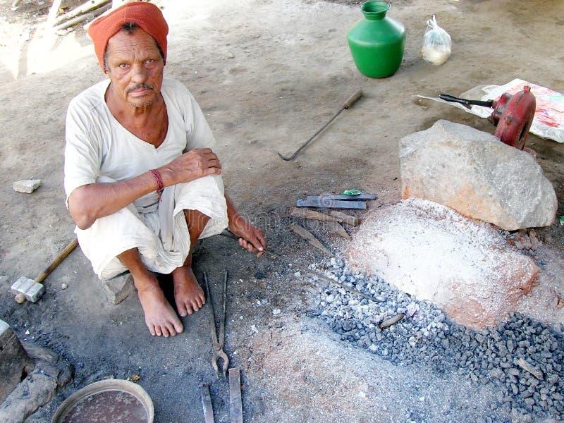 Индийский blacksmith стоковые изображения