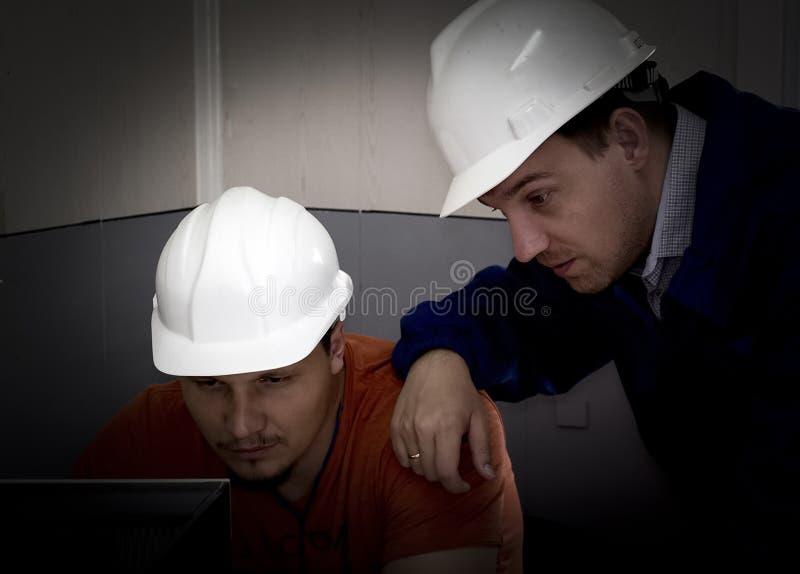 инженеры стоковое фото