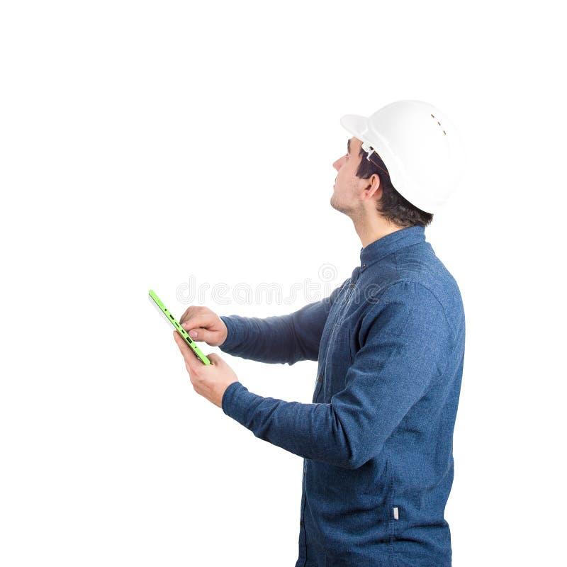 Инженер используя планшет стоковые изображения