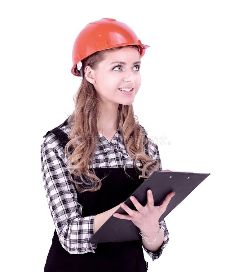 Инженер молодой женщины подписал документ r стоковое изображение