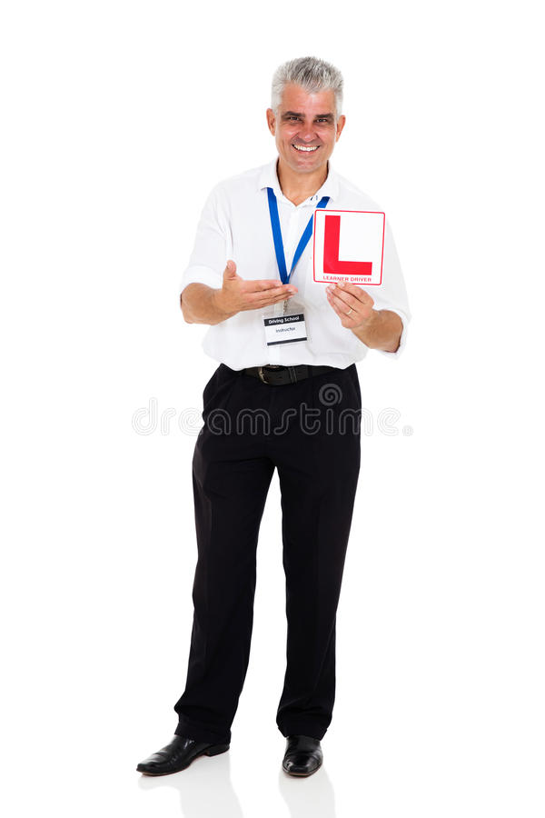 Инструктор по вождению показывая знак стоковая фотография rf