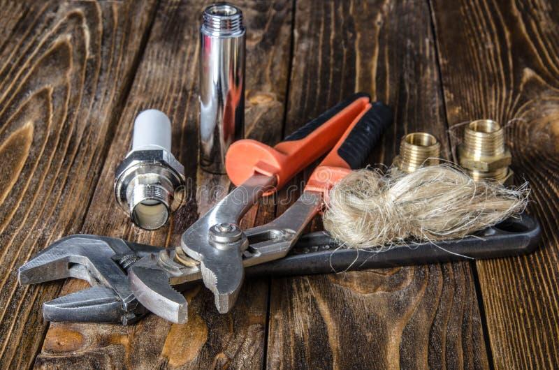 Инструменты и материалы для ремонта водоснабжения стоковое изображение