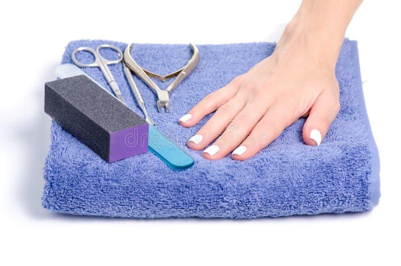 Инструменты маникюра рук полотенца женские стоковая фотография