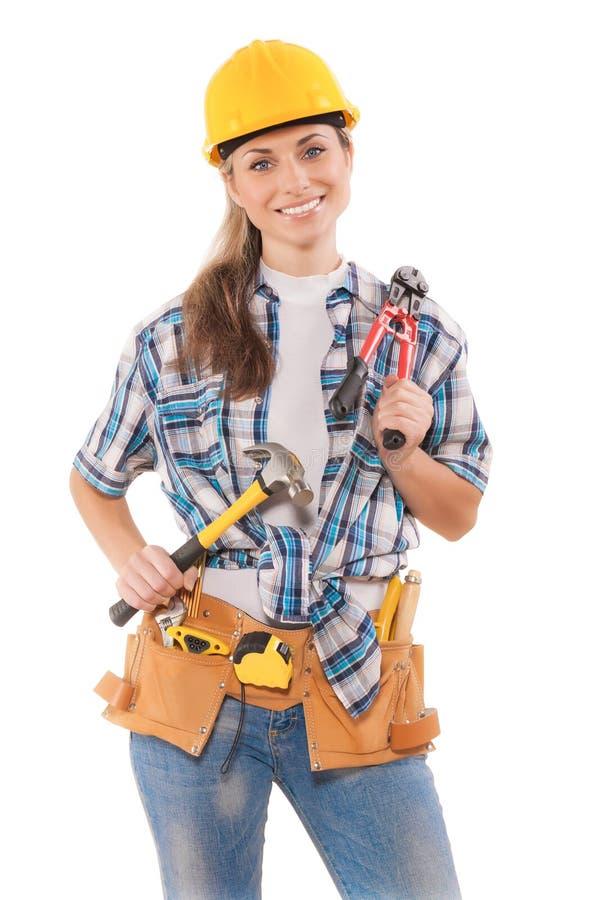 Инструменты удерживания женского работника изолированные на белизне стоковое изображение rf