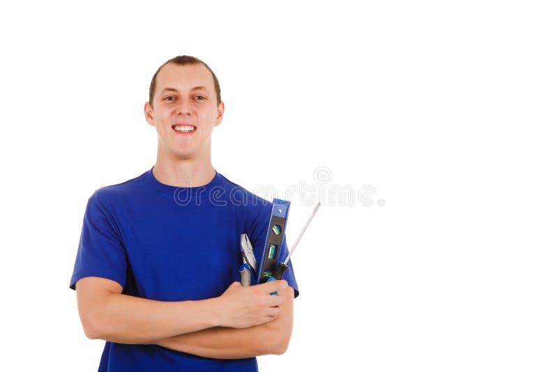 Инструменты удерживания работника изолированные в белой предпосылке стоковая фотография rf