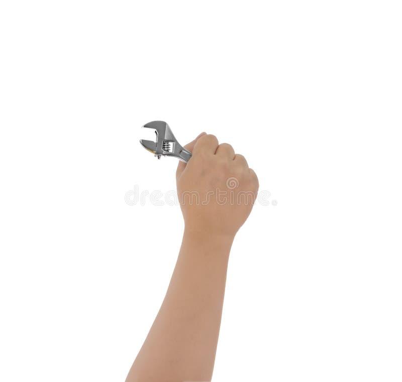 Инструмент гаечного ключа владением руки механика в изолированной руке стоковые изображения rf