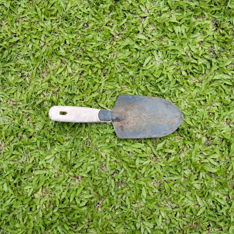 инструмент лопаткоулавливателя травы сада 3d изолированный изображением стоковое фото rf