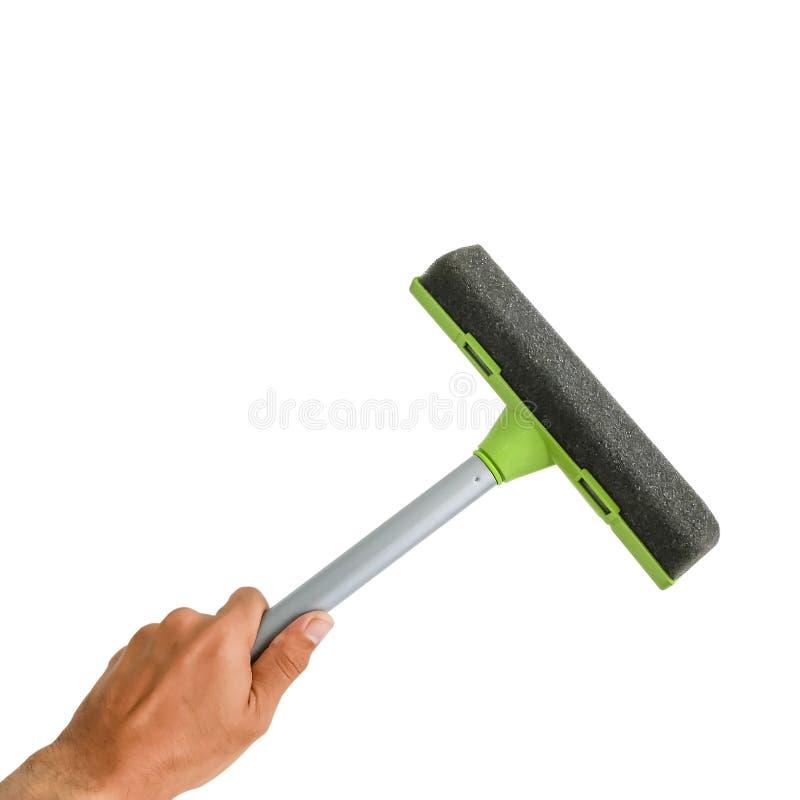 Инструмент стеклянного уборщика в руке стоковое изображение