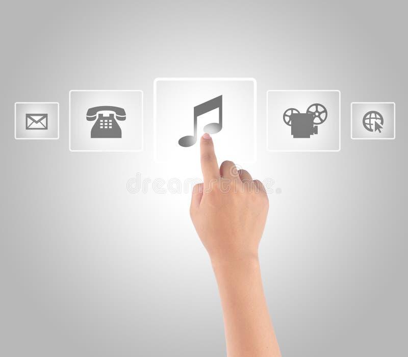 Интерфейс средств массовой информации руки касающий стоковая фотография