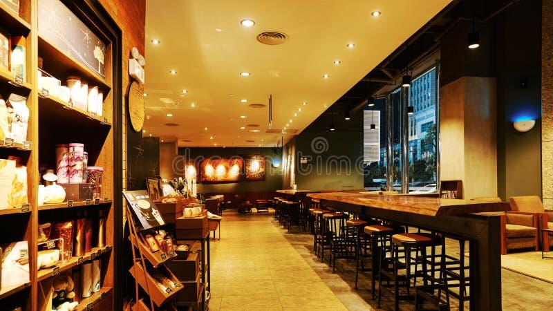 Интерьер кофе Starbucks стоковые фотографии rf