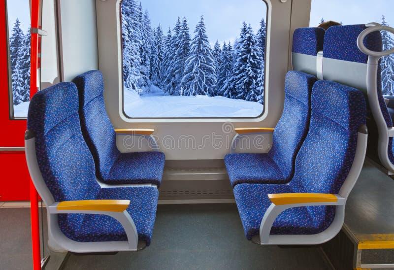 Интерьер поезда и пущи зимы стоковое фото rf