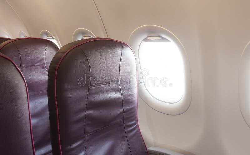 Интерьер самолета с стулом стоковое фото