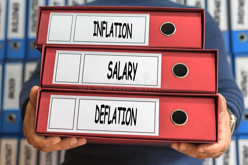 Инфляция, зарплата, слова концепции дефляции представленное изображение скоросшивателя принципиальной схемы 3d кольцо стоковые изображения